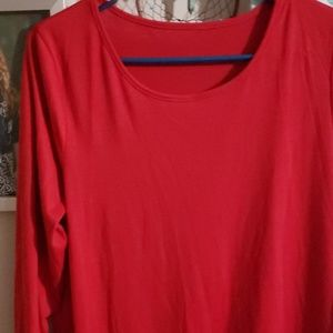 Red shirt with ruffles at bottom